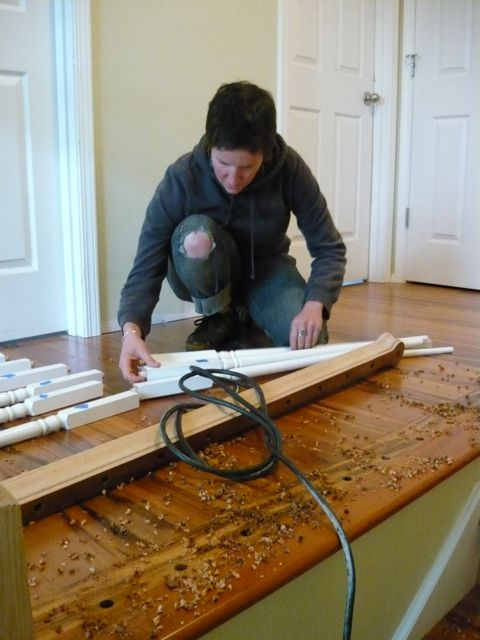Stacey reassembles the handrail and balusters